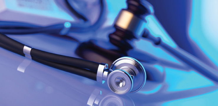 photo of stethoscope and gavel