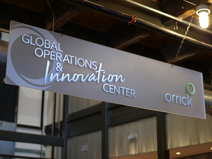 photo of new Global Operations & Innovation sign in Wheeling lobby